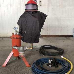 Protective suit with pump system and hoses connectors for dustless blasting